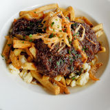 Poutine with braised ribs Royalty Free Stock Photo