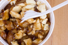 Poutine canadian fastfood meal with french fries Stock Image