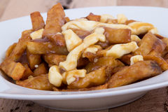Poutine quebec meal with french fries Royalty Free Stock Images