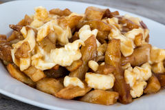 Poutine quebec meal with french fries Stock Images