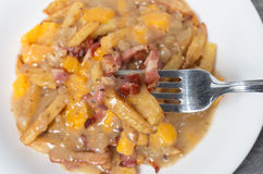 Poutine with yellow cheddar cheese Stock Images