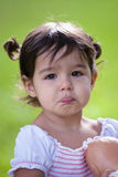 Pouting baby girl with big brown eyes Stock Photography
