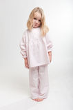 Pouting blonde kid in her pajamas Royalty Free Stock Photo