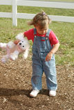 Pouting Child with Stuffed Animal in Hand Stock Image