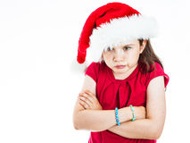 Pouting Christmas girl. Portrait of a little girl wearing a Christmas Hat, pouting and shrugging Stock Photography