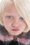 Pouting Face. Beautiful little girl with big blue eyes, blonde hair, and a pouty face Stock Photography
