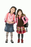Pouting Girls. Two young asian girls ready for school Royalty Free Stock Image