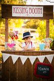 Pouting at kissing booth Stock Photo