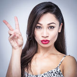Pouting Red Lips Girl Victory Sign Stock Image