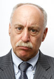 Pouty Businessman. A bald businessman, isolated on a white background, pouts Stock Photography
