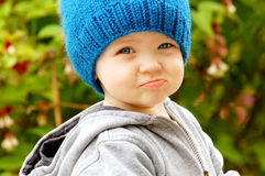 Pouty Faced Cutie. Cute kid making a funny, pouty face at the camera Royalty Free Stock Photo