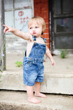 Pouty little boy in overalls. Little boy in overalls pointing and pouting Royalty Free Stock Photos