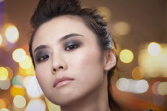 Pouty Young Woman with Smoky Eyes Looking At Camera Stock Photography