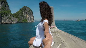 POV beautiful woman sitting on Thailand boat nose holding man hand action camera view stock footage