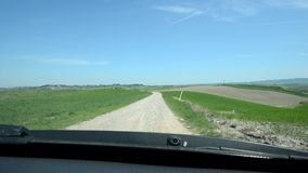 Car going slow in a Tuscan landscape stock video footage