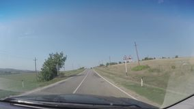 POV car moves on narrow road. View of perspective of road.