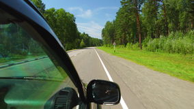POV: Car is moving across the forest in sunny day on a highway in Altay, Russia. POV: Car is moving across the forest in sunny day on a highway in Altay Russia stock video footage