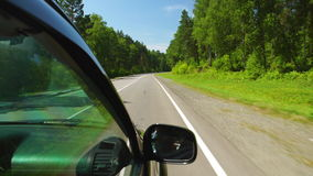 POV: Car is moving across the Wood in sunny day on a highway in Altay, Russia. POV: Car is moving across the Wood in sunny day on highway in Altay, Russia stock footage