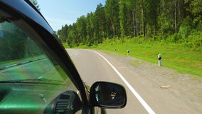POV: Car is moving along the forest and mountain on a highway in Altay, Russia. POV: Car is moving along forest and mountain on a highway in Altay, Russia stock video footage