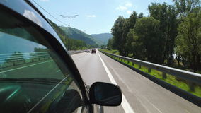 POV: Car is moving along the Katun river on a highway in Altay, Russia. POV: Car is moving along the Katun river on a highway in Altay Russia stock footage