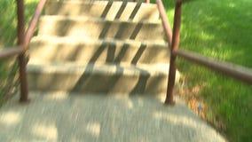 POV of climbing stairway stock video