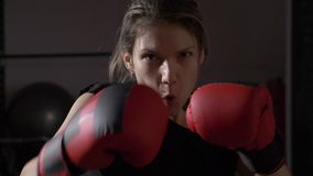 POV close up of beautiful female model looking into the camera and shadow boxing in slow motion -. POV close up of beautiful female model looking into the camera stock video