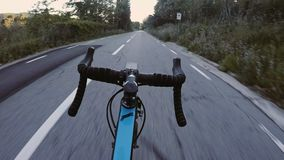 POV of cyclist riding bike in sunset. POV of cyclist not holding hands on handlebar and bicycle descending very fast downhill without control. thrilling and stock video footage