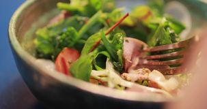 POV, eating fresh salad, smoked duck meat on a fork, food video