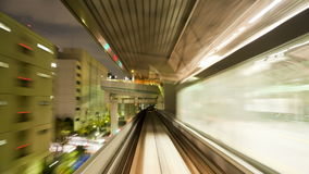 Pov elevated train line across the rainbow bridge and through tokyo stock footage