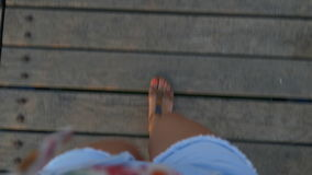 Pov feet of a woman walking on the pontoon stock video