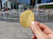 POV Food, a potato crisp being consumed in London stock image