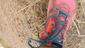 POV footage of runner feet running at forest stock video footage