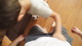 POV: Home football - Father plays with a son at home stock video