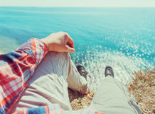 POV image of man sitting on coast Stock Photography