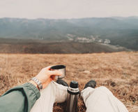 POV image of traveler with thermos Royalty Free Stock Images