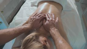 POV of man doing massage the young beautiful woman at luxury spa salon stock footage
