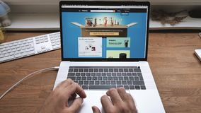 POV man shopping Amazon Prime Day on laptop France scroll website. Paris, France - Jul 16: Man hands POV scroll shopping on Apple MacBook Pro 15 laptop with stock video
