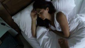 POV of man walking in bedroom walking up sleeping woman morning stock video footage