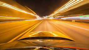 Pov night driving hyperlapse at a modern highway passing a series of tunnels. 4K drive pov modern highway timelapse, hyperlapse night.Pov night driving stock video footage