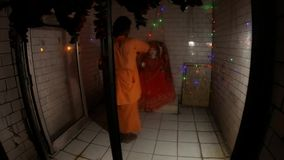 POV one looks on hindu monk performed night aarti in front of idol of Mata Parvati