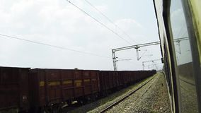 POV out train,Train Passing On Fast View Of The Side Of A Passenger Train While Railroad Tracks. POV out train,Train Passing On Fast View Of The Side Of A stock video footage