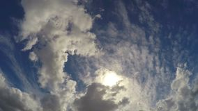 POV of person lying on ground and looking up to the sky, clouds floating by stock video
