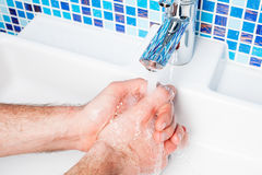 POV person washing hands. Point of view shot of a man washing his hands in a bathroom sink Royalty Free Stock Photos