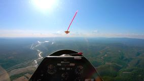 POV of pilot flying small private jet or glider