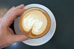 Man drinks flat white coffee drin Royalty Free Stock Photo