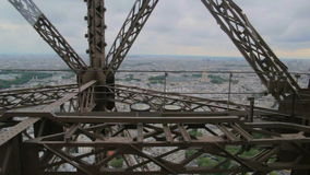 POV the rise inside the Elevator to the Eiffel tower - iron girders pass camera as elevator rises in Paris, France. Point of view stock video footage