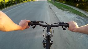 POV Road cyclist on asphalt road at sunset. Ridind through the city khmelnytskyi ukraine stock video