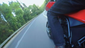 POV shot of from a fast motorcycle driving on a curved road. POV shot of from fast motorcycle driving on a curved road at high speed stock video
