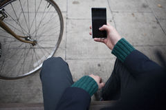 POV shot of hand, legs and mobile phone Royalty Free Stock Photo