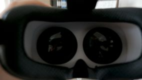 POV shot of putting VR virtual reality headset on